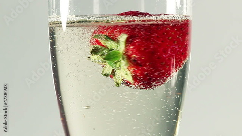 rotating strawberry in champagne