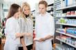 Pharmacist Assisting Female Shopper