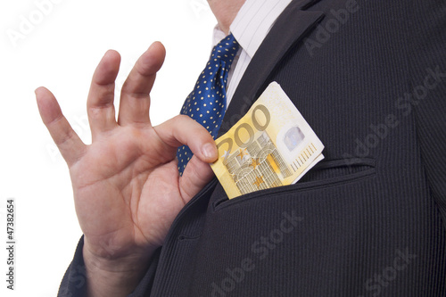 Man putting money in his pocket