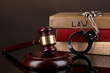 Gavel, handcuffs and.books on law isolated on black close-up