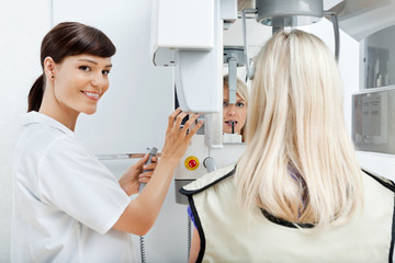 Female Dentist Getting Her Patient's Teeth X-Rayed