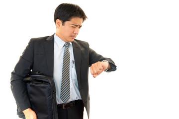 遅刻するビジネスマン