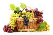 assortment of ripe sweet grapes in basket, isolated on white.