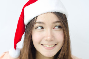 Portrait of Asian christmas girl wearing santa hat.