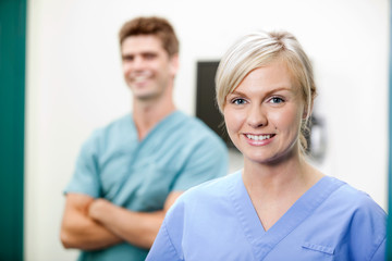 Young Female Vet In Scrubs Smiling
