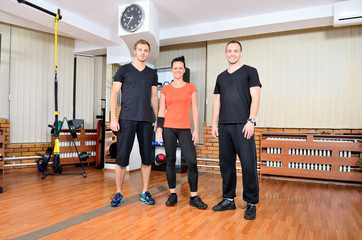 Personal trainers in gym