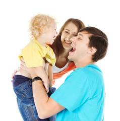 Happy family playing with child raising him up over white