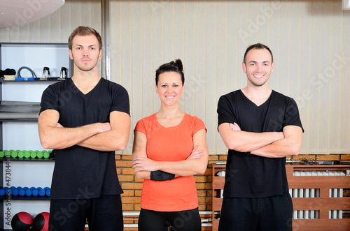 Young handsome people in gym