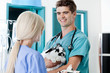 Veterinarian Doctor With Rabbit Looking At Female Nurse
