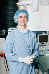 Cheerful Male Surgeon With Hands Clasped