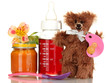 Baby bottle with fresh juice, puree and teddy bear isolated