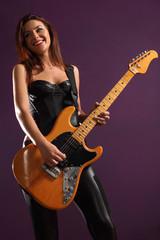 Happy female guitarist