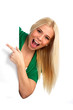 Young happy woman pointing at something