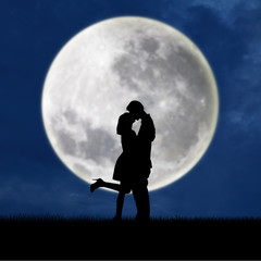 Couple in love on blue full moon silhouette