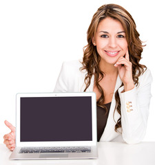 Businesswoman showing a laptop screen
