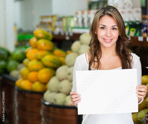 Woman with an open sign at her business