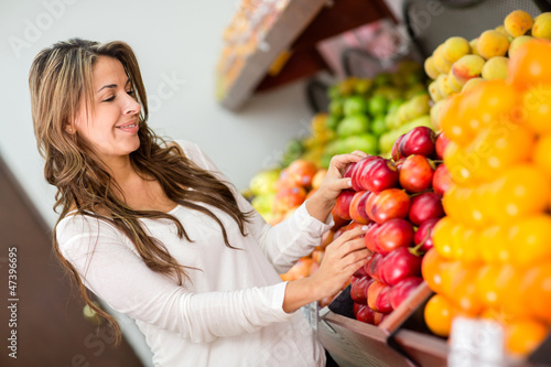 Woman buying fruits at the supermarket