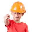 Little girl in the construction helmet