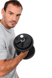 man training with a dumbbell