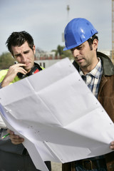 Foreman and colleague checking over plans