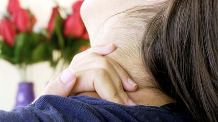 Closeup of hand touching sick sore neck