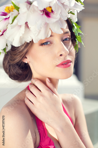 portrait of fashion woman with flowers on head, spring