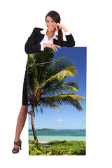 Agent with a poster of a tropical beach