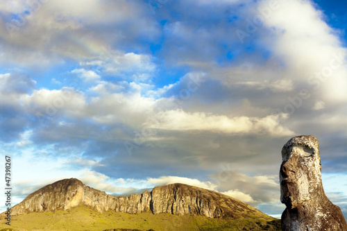 Head of moai with mountain in background in Easter Island