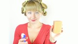 woman housewife in curlers with detergent