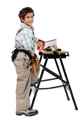 Full length shot of a young boy pretending to be a carpenter