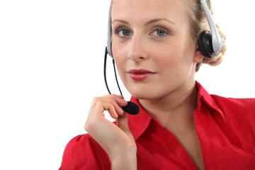 Woman wearing a telephone headset