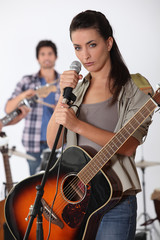 pretty brunette singing with band