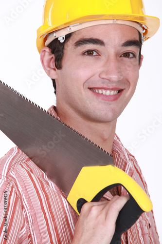 Young carpenter holding hand-saw