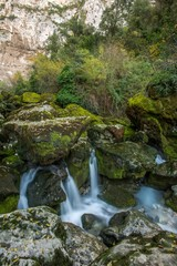 Stream running between rocks in  Fontaine-de-Vaucluse, France