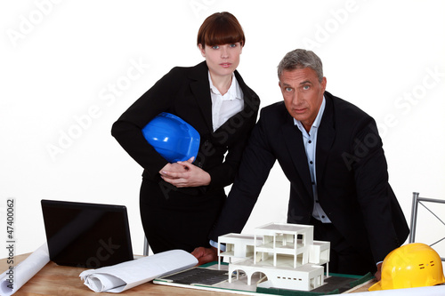 Architect and colleagues preparing business proposal