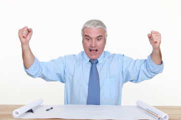exited businessman raising his hands