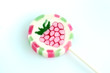 strawberry lollipop on white background