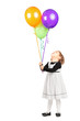 Full length portrait of a girl looking at bunch of balloons