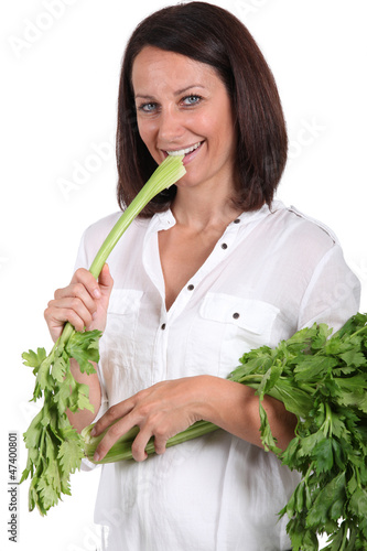 Woman eating a branch of celery