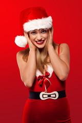 Joyful woman in a Santa Christmas outfit