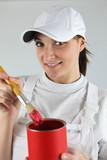 Female decorator has chosen red paint