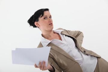 Secretary holding paperwork