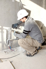 Plumber working on a site