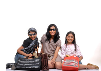 Happy young friends with shopping bags