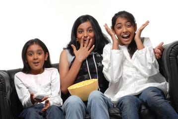 Group of girls  watching TV