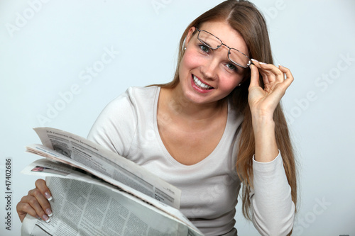Woman reading the newspaper.