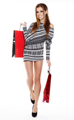 Shopping woman walking and holding bags - isolated over white