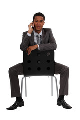 Businessman sat casually during call