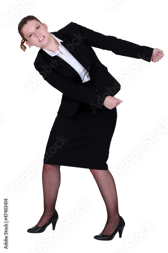 Businesswoman miming that she is pulling something.