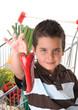 Little child holding red pepper